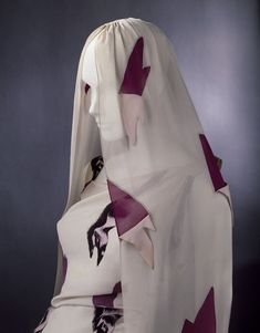 The Tears Dress; The Circus Collection  Object: Evening ensemble (dress and veil)  Place of origin: Paris, France (made)  Date: February 1938 (made)  Artist/Maker: Schiaparelli, Elsa, born 1890 - died 1973 (designer)  Dali, born 1904 - died 1989 (textile, designer)  Materials and Techniques: Viscose-rayon and silk blend fabric printed with trompe loeil print