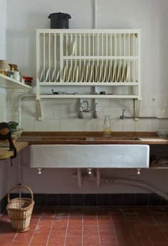 The sink and plate rack in the Kitchen at Coleton Fishacre, Devon.