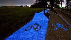 This solar-powered glow-in-the-dark bike path in Poland helps bikers stay safe while enhancing the scenery. Luz Solar, River Trail, Walking Paths, Bike Path, Path Lights, Eindhoven, Bike Trails, Trends, Pavement