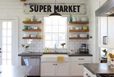 Open shelving, white subway tile- Like this but instead of the window and sink you'd have a really great stove and vent hood.