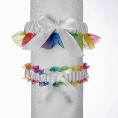 Whether you want something satin, something blue, or something trendy and new; take a look at our Rainbow wedding garter set - perfect to celebrate your Lesbian wedding ceremony.  The rainbow garter set includes white or ivory satin with rainbow organza with a keepsake and tossing garter.  One size fits most.