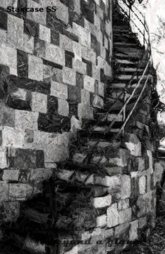 An architectural print of a winding staircase with multiple textures of brickwork create an interesting and intriguing pattern.  This brick staircase print highlights the masonry and ironwork that Savannah is known for. This black and white winding staircase is available in a few different finishes only available at the DSGgallery. See this and more prints like it by visiting the DSGgallery at our Etsy shop at this link:  https://www.etsy.com/shop/DSGgallery