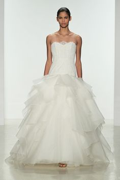 """Nayri"" by Kenneth Pool. Dropped waist ballgown with lace bodice and organza layered skirt."