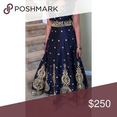 Indian party wear outfit Navy blue with handwork designs all over. Dresses