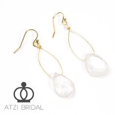 Atzi Bridal Quartz Drop Earrings  Perfect for the nature-loving bride! Subtle beauty that can also we worn after the wedding day! Matching layered necklace also available!  #atzibridal #bridal #bride #jewelry #bridaljewelry #bridalfashion #weddinginspiration #quartz #dropearrings #handmade #handmadejewelry #photooftheday by atzibridal
