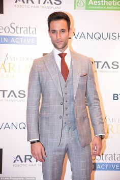 Playing the dapper gent: Emmerdale's Rik Makarem looked the definition of a dapper gent, as he donned a grey, three-piece checked suit.