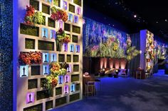 Academy of Motion Picture Arts & Sciences Governors Ball- Cutouts could be hexagons....or the whole wall could mimic the stacked hexagons on stage...display jewelry instead of oscars