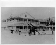 "White's Point Hot Springs (also  known as ""White Point"") two-story hotel, with Rámon  Sepúlveda (b. 1854), son of José Diego Sepúlveda, on horseback next to fountain in foreground."