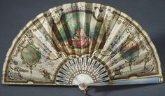 Queen Mary's Fabergé fan. Creator: Henrik Emanuel Wigström (1862-1923) (workmaster). Creation Date: c. 1912. Plain weave cream silk leaf, backed with silk gauze; front guard of mother-of-pearl with two-colour gold enamelled in blue and white over a guilloché ground, decorated with two Burmese cabochon rubies; back guard and sticks of mother-of-pearl.