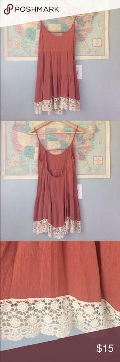 Looks Like Anthro! Coral Rust Tank with Lace MED Looks like something you would find at Anthro! Size Medium. Rusty coral color with cream Lace at the bottom. Back of tank is slightly longer than front. Keyhole back! Excellent condition. Jesse & J Tops Blouses