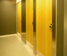 Ironwood Manufacturing metal toilet partition and wood veneer bathroom doors. Beautiful, upscale public restroom stalls.