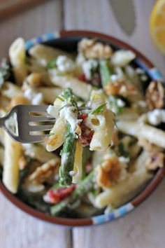 Creamy Meyer Lemon Pasta  It's filled with roasted asparagus and sun dried tomatoes along with crumbled goat cheese, crunchy toasted walnuts and a creamy Meyer lemon pasta sauce