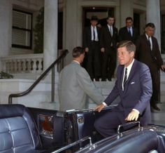 President Kennedy entering his Lincoln convertible