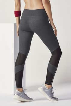 Dial in on style and support in our open-back tank with a built-in bra and breathable compression leggings.