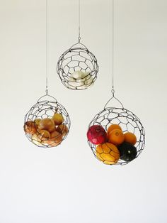 Hanging Wire Fruit/Vegetable Sphere Basket. Would be awesome hanging them in the corner under the cabinets in the kitchen or over the island. you can be so creative when it comes the these!