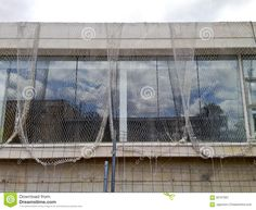 Security Net For A Building At Construction Stock Image - Image of real, building: 56767997 Stock Photos, Building, Image, Buildings, Construction