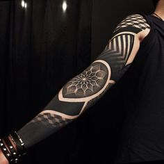 Dotwork is perfect with blackwork, here for a breath-taking geometric sleeve by Ervand Akopov...