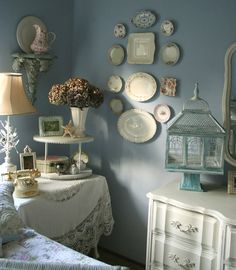 Love this corner, perfect inspiration for using plates, sconces and sassy draped bedside table