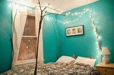 DIY bed frame using branches & stringed lights. @Martha Blackwood  Lauren's Room Ideas?