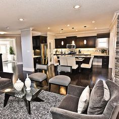 Kitchen colors espresso flat cabinets, white counters, stainless steel appliances, med dark hardwoods, light paint