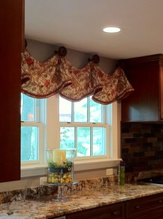 Custom Window Treatments by Windows Etc., Inc., Oswego, IL.....Kitchen Valance, trimmed at bottom edge, mounted with decorative Medallions.