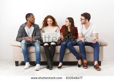 Happy multiethnic friends in casual clothes sitting on sofa in living room and talking, leisure time Casual Clothes, Casual Outfits, Mom Jeans, Sofa, Living Room, Friends, Happy, Pants, Image