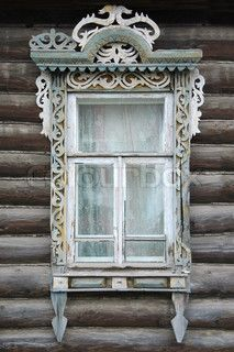window of an old Russian house with decorative carvings