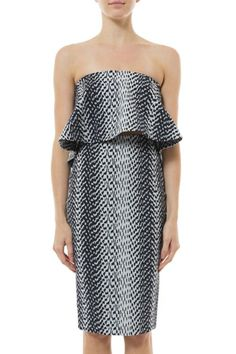 A fitted pencil skirt from Elizabeth and James that features a back slit and exposed zip. Pair it with a button up blouse for work or a crop top for a night out. Lined.  Ikat Aisling Skirt by Elizabeth & James. Clothing - Skirts - Pencil Canada