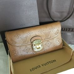 Louis Vuitton Mahina Amelia long wallet Absolutely fabulous wallet ever made by LV! This Mahina Amelia wallet is in perfect condition! Clean inside and out, even inside the coin pocket is clean! ...some scratch on the front hardware but the zipper pull is in very good condition... It has my consignor's initials in pink. This comes with original box, dust cover, and the shopping bag Louis Vuitton Bags Wallets