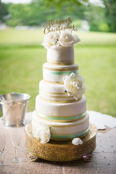 five tier wedding cake with gold and green stripes