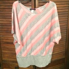 Dressy pink top Mid length sleeves with stripped pink and grey shirt. Fits well on someone with some curves! Tops