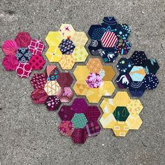 First eight #hexies done! Im really enjoying going through my scraps to find these little treasures. As I go along and prep #hexagons Im able to sneak some fussy cut fun in. . . . #kingfisherstitchalong #epp #englishpaperpiecing #scraphappens #scrapstashbusting #handsewing #handpiecing #quilting #sewing #slowsewing