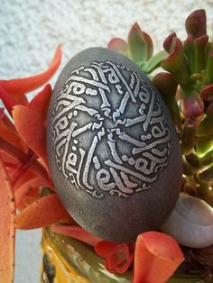 Acid etched goose eggshell with Arabic Caligraphy and an aged metal patina