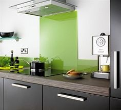 Kula glass splashback, new range at  Topps Tiles. Water and stain resistant, and all colours are UV stable so they won't fade. Splashbacks are made to order, but to give an indication of cost, for size 70 x 60 cm the price is £85.