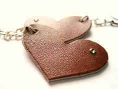 Leather heart earrings with tiny swarovskis