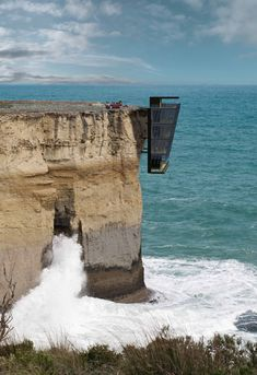 "Cliff house designed to hang off a precipice like ""barnacles clinging to a ship's hull""."
