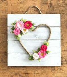 This listing is for a Felt Flower Heart Wreath wall hanging. The wood plaque is handpainted/white washed and then lightly distressed. Hand cut wool felt flowers and leaves are added layer by layer. This 10x10inch wall hanging would be a great addition to nursery, bedroom, entryway or