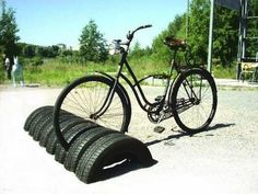 Reuse tires as bike storage. http://hative.com/creative-ways-to-repurpose-old-tires/