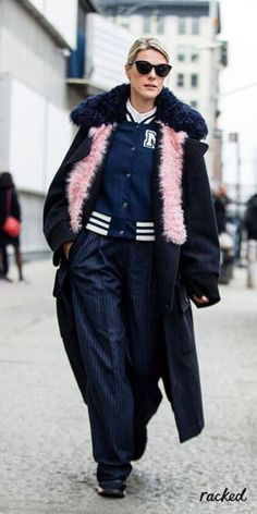 Pink Fur Snood Worn Over a Varsity Jacket Layered Under a Wool Coat at New York Fashion Week // More Winter Style Ideas from the Best NYFW Fall 2016 Street Style: (http://www.racked.com/2016/2/12/10966400/nyfw-street-style-fall-2016)