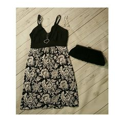 Black and White Dress Black and white floral print dress, ties in back. Adjustable spaghetti straps. Dresses Mini