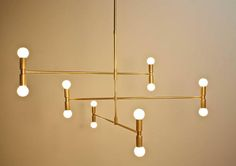 Radius 12 - 12 bulbs raw solid brass chandelier that blends to perfection the mid-century style and modern together. Materials Raw Unfinished-Unlacquered Solid Brass Dimensions 37 wide (at widest) 21 hight (excluding drop rod) 12 drop included* Total height : 33 ( from ceiling to bottom of fixture) *Drop length is customizable - Please contact us for dimensions and pricing before buying G9 system LED bulb 12 X 3.5watts 2700k (warm light) bulbs included Bulb cover included Solid brass c...