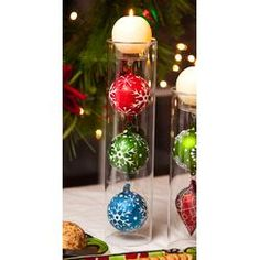 Holiday Festivities Ornaments in Glass Candle Holder