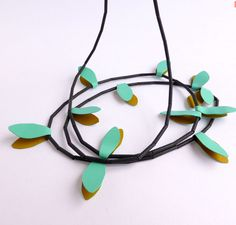 """Necklace """"Turquoise Wings"""" by Montse Basora."""