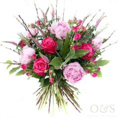 Valentine's Day wild and natural pink bouquet. Gorgeous flowers in bright pinks and  cerise roses with soft pink peonies and fresh blossom by London based Floral Designers Okishima & Simmonds. www.okishimasimmonds.com