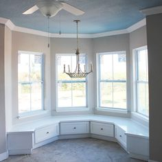 Custom built in benches kitchen nook curved bump out window