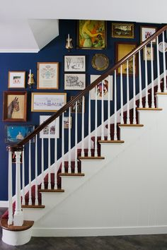 Benjamin Moore Washington Blue stairwell wall with art and white stairs. wall Blue and Red Entrance Painted in Benjamin Moore Washington Blue Stairwell Wall, Stairway Walls, Staircase Wall Decor, Stair Art, Staircase Design, Picture Wall Staircase, Stair Decor, Staircase Pictures, Entryway Stairs