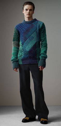 A longline sweater in cashmere and wool. The patchworked design is made in Wales from mouliné yarn for a marble-effect finish. Chunky cable-knit panels take inspiration from sweaters worn by fishermen of the British Isles.