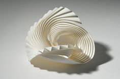 English artist Richard Sweeney creates delicate modular sculptures out of paper.
