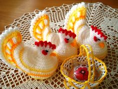 Egg Warmers - Lovely Crochet Chickens *Wool, Cotton and Acrylic Yarn *It will fit regular size chicken egg or plastic egg *Excellent gift and or Easter Breakfast decoration *Around 4inches tall Note: *Delivered to you ribbon wrapped ready GIFT !!! *Open & Closed tail means - one hen will have closed tail and the other open; size remain the same.