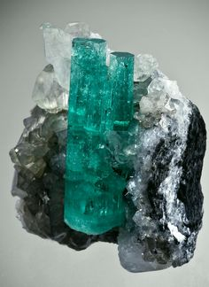 Emerald with Calcite from Coscuez Mine, Boyaca Dept., Colombia Credit: The Arkenstone Amazing Geologist Minerals And Gemstones, Rocks And Minerals, Beautiful Rocks, Emerald Gemstone, Stones And Crystals, Gem Stones, Rocks And Gems, Fossils, Design